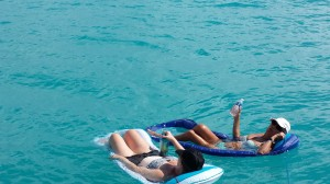 Debby and Julie relaxing in the calm blue waters of Barbuda.