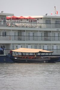 Sampam pulling along side the Mekong Navigator.  Sampan hold ~24 people.
