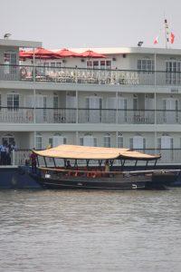 Sampam pulling along side the Mekong Navigator.  Sampan hold ~24 people.