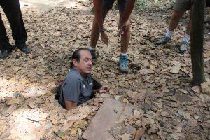 Rocky descending into the hidden tunnel - a tight squeeze.