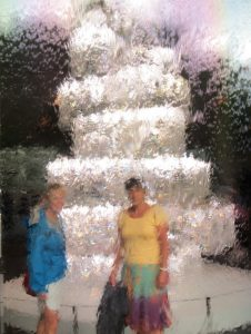 Impressionist photo of Pam & Julie behind a waterfall pane