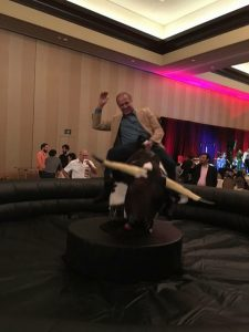 Rocky riding the mechanical bull