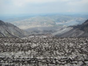 The view to the north from Mt. St. Helens crater summit looking at the current lava dome in the crater and viewing the still devastated area from the 1980 blast.