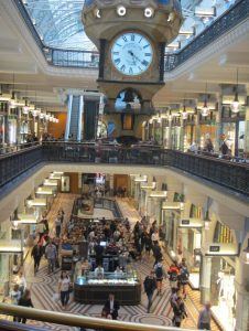 One of the famous clocks suspended in the Queen Victoria Building