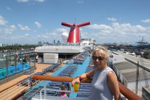 Julie on deck of the Carnival Splendor getting ready to set sail from Miami, Florida