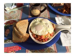 """Sunday morning breakfast at """"The OEC"""", The Over Easy Café, where visitors and local both congregate"""