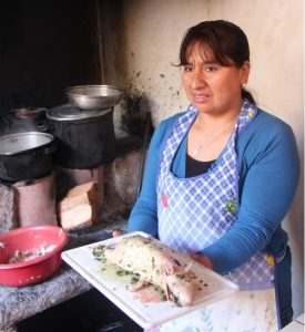 Emma, Our Urubamba Home Host making Guinea Pig